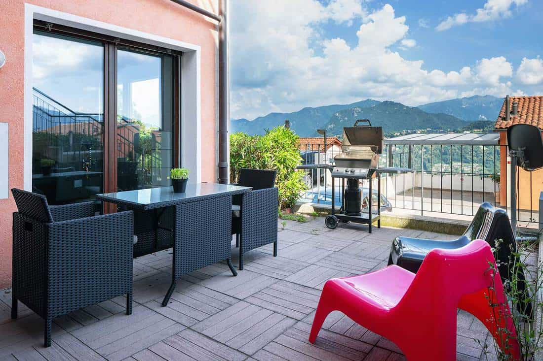 Veranda with garden furniture, blue sky and views of the mountains