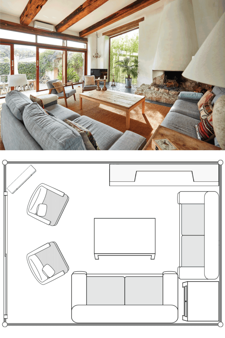 View of a spacious living room with fireplace in a bright Mediterranean farmhouse
