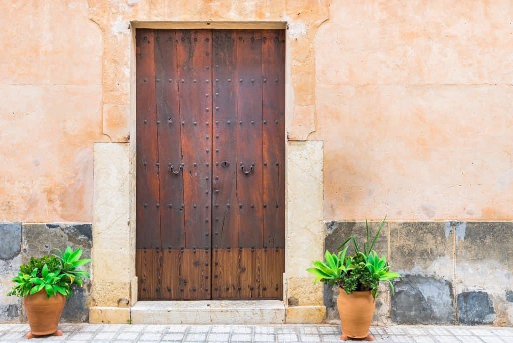 View of brown wood door of vintage villa