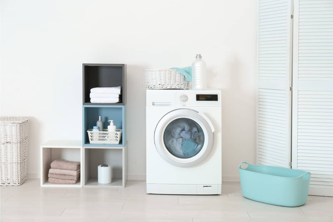 Washing of different towels in modern laundry room. Fun Colored Accessories in Your White Laundry Room