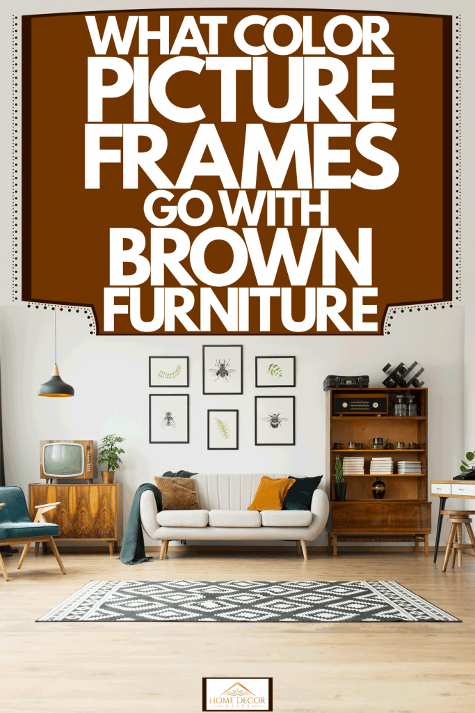 Interior of a white walled living room with six picture frames on the wall, a loveseat sofa, and wooden furniture's on the sides, What Color Picture Frames Go With Brown Furniture?