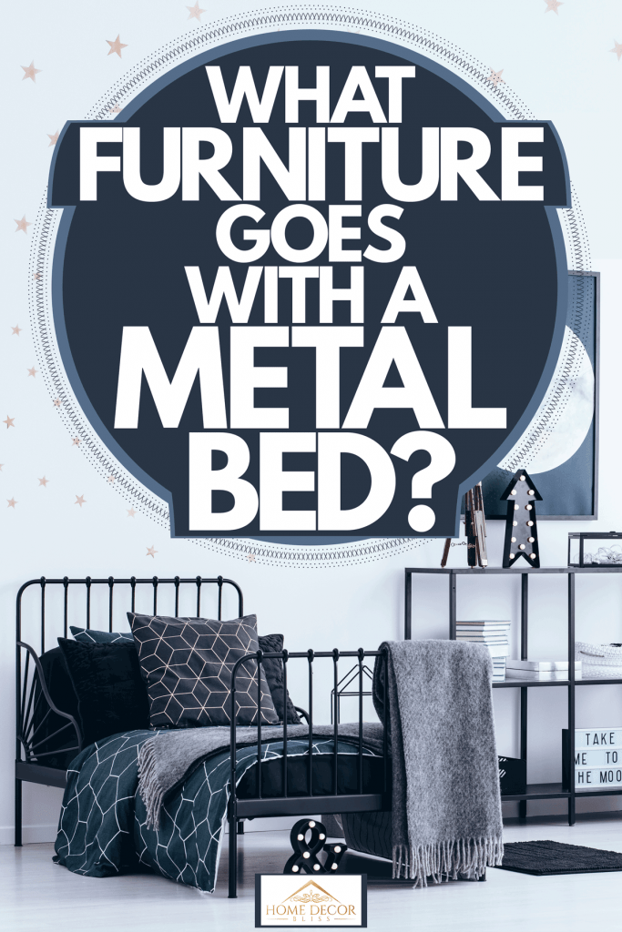 Modern interior of a white and industrial themed bedroom with a metal framed bed and white curtain on the side, What Furniture Goes With A Metal Bed?