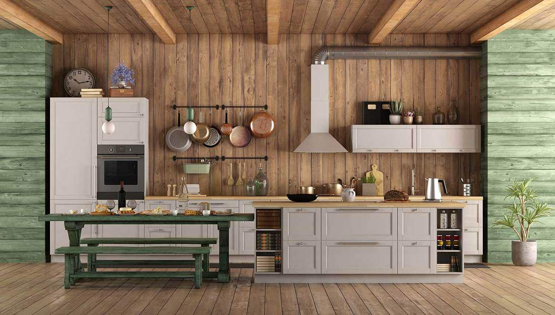 White and green retro kitchen with island, dining table and bench