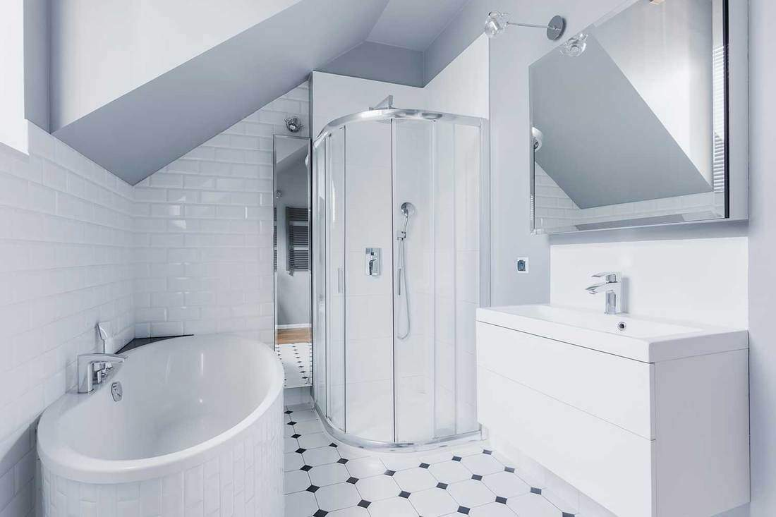White bathroom in classic style with glass shower