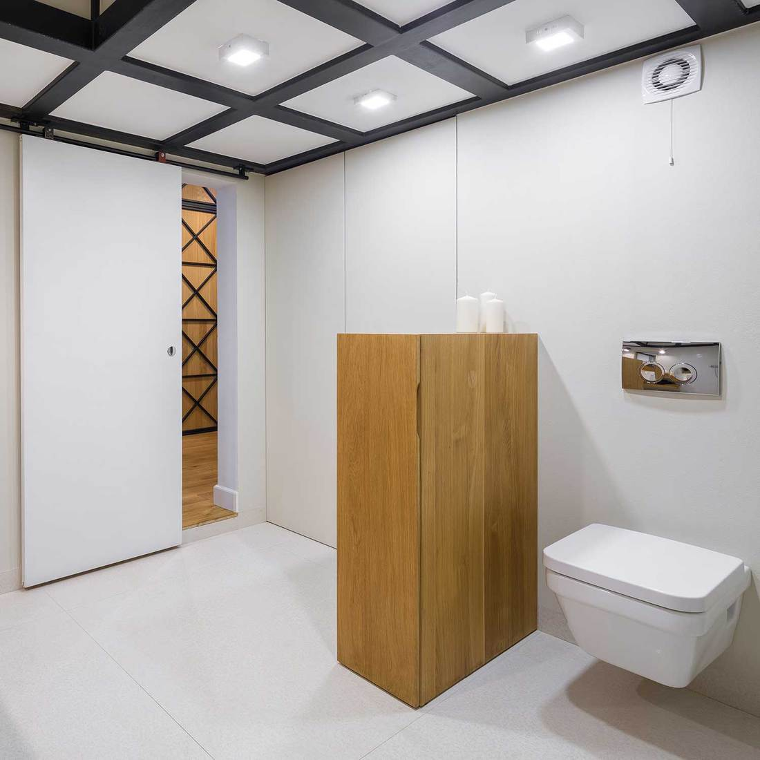 White bathroom with wooden furniture and coffered ceiling