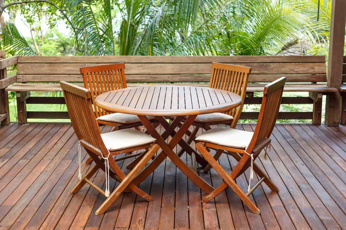 Wooden outdoor dining furniture with wooden flooring