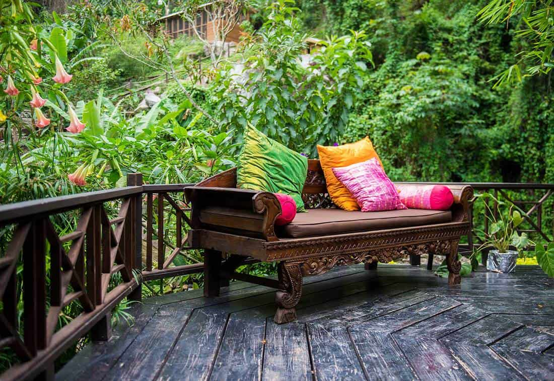 Wooden packyard patio with sofa and pillows