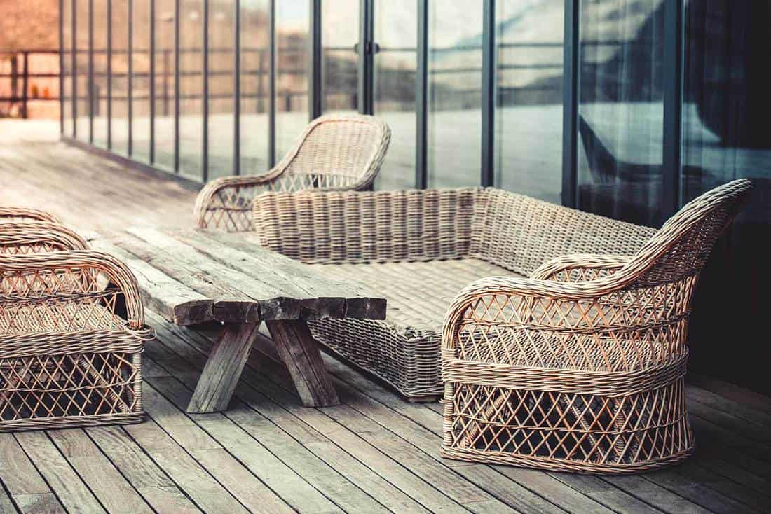 Wooden terrace with wicker sofa set and wooden table