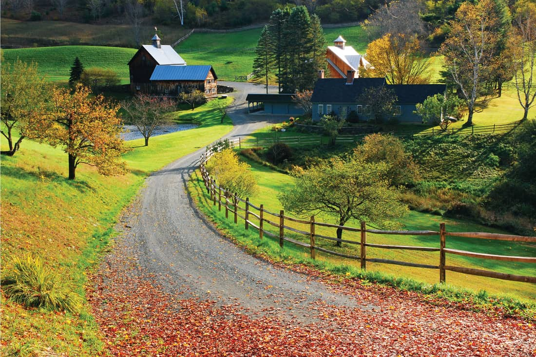 a winding country road passes though a bucolic farm in autumn. Border Your Long Gravel Drive With A Split Rail Fence