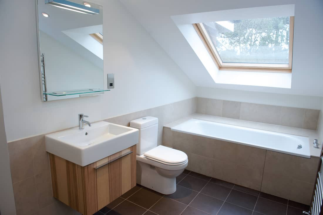 all white bathroom with wood accents. Tuck Your Tub Away In An Attic Bathroom