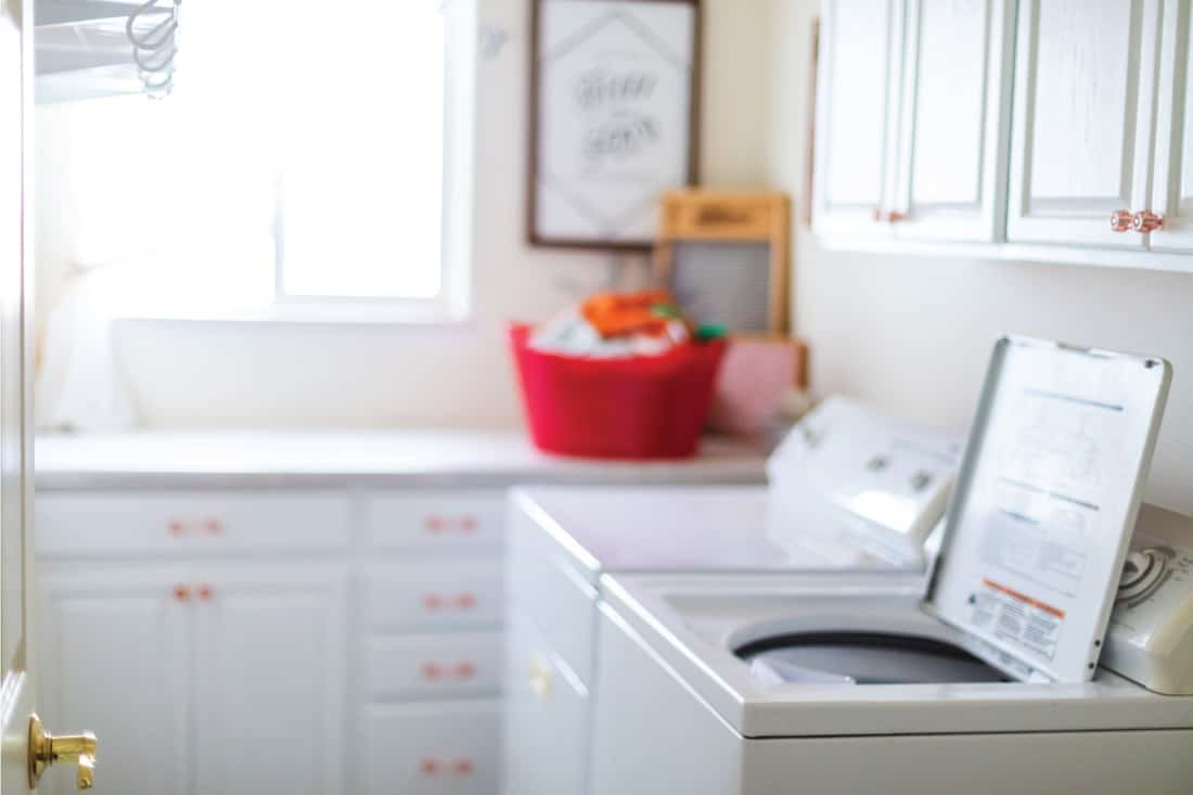 all white laundry room with Dress Up Your White Cabinets With Colorful Knobs And Pulls