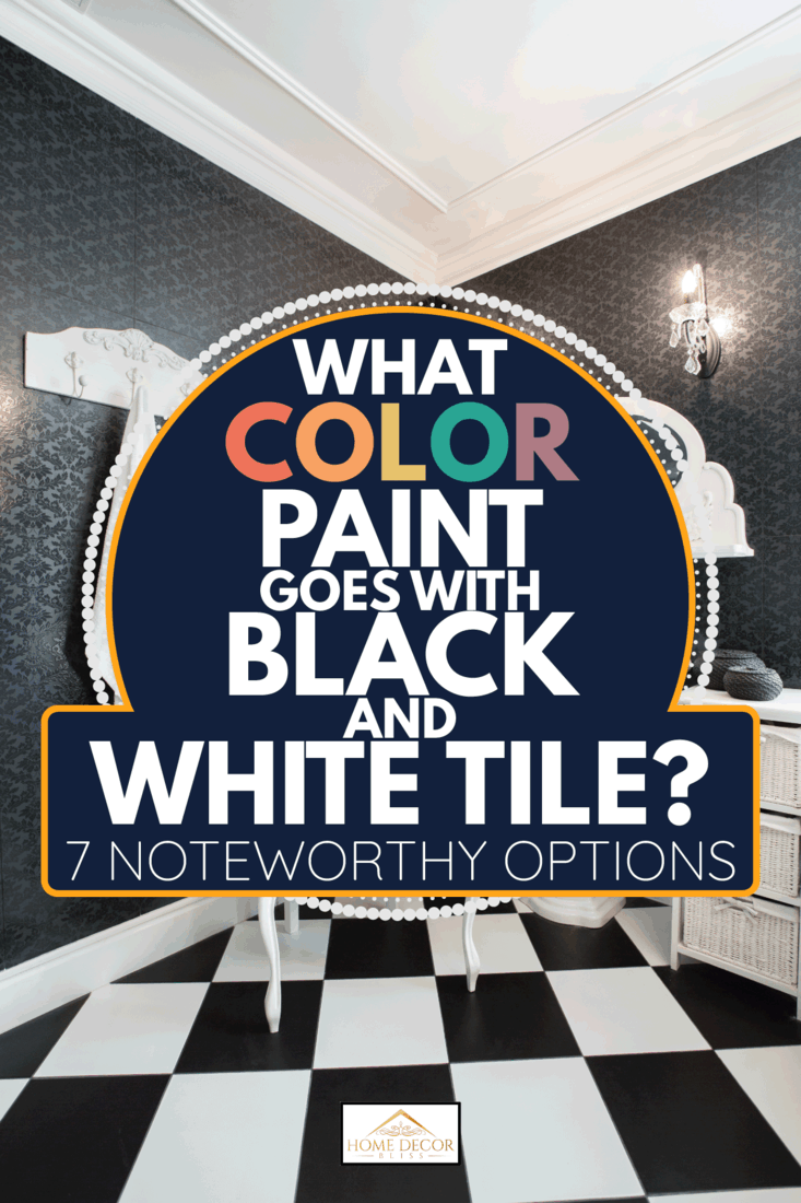 modern bathroom with black and white tiles, white vanity mirror frame and sink. What Color Paint Goes With Black And White Tile [7 Noteworthy Options]