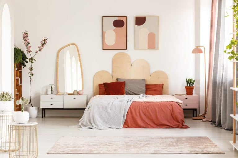 bed with headboard in pastel bedroom interior with mirror. How To Attach Headboard To Bed Frame In 4 Steps