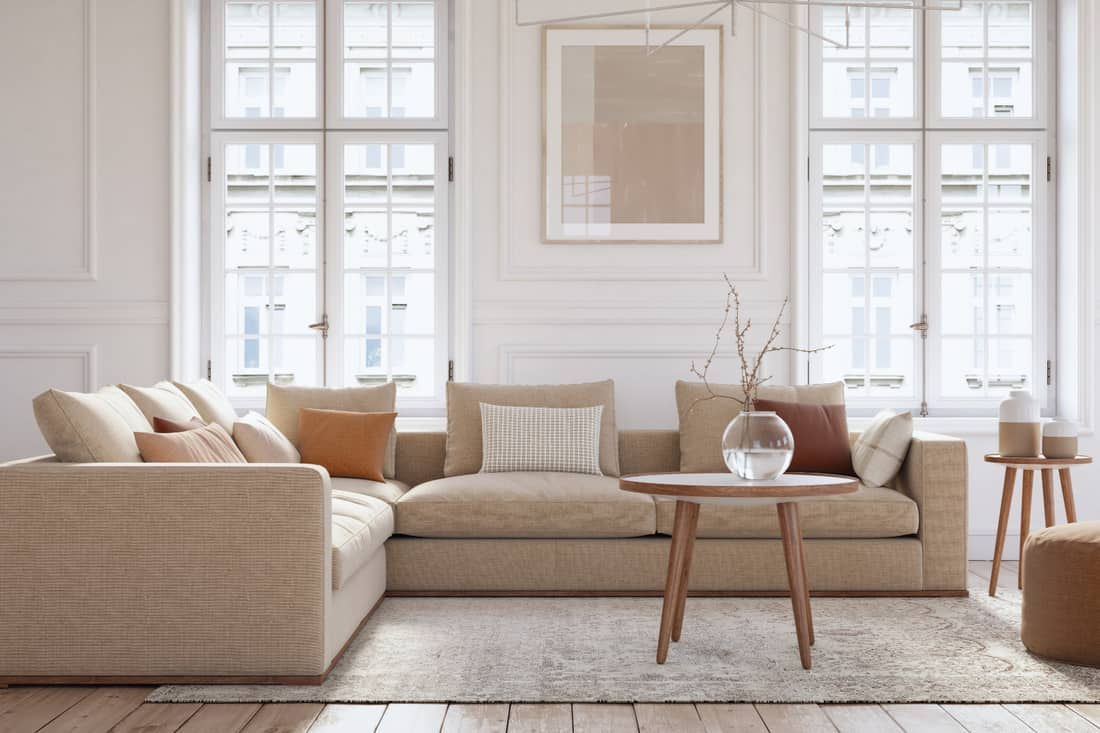 beige colored furniture and wooden elements. coffee table, end table, ottoman, and throw pillows