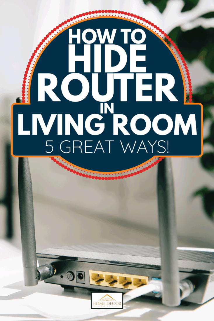 black plugged router on white table and businessman sitting on sofa. How To Hide Router In Living Room [5 Great Ways!]