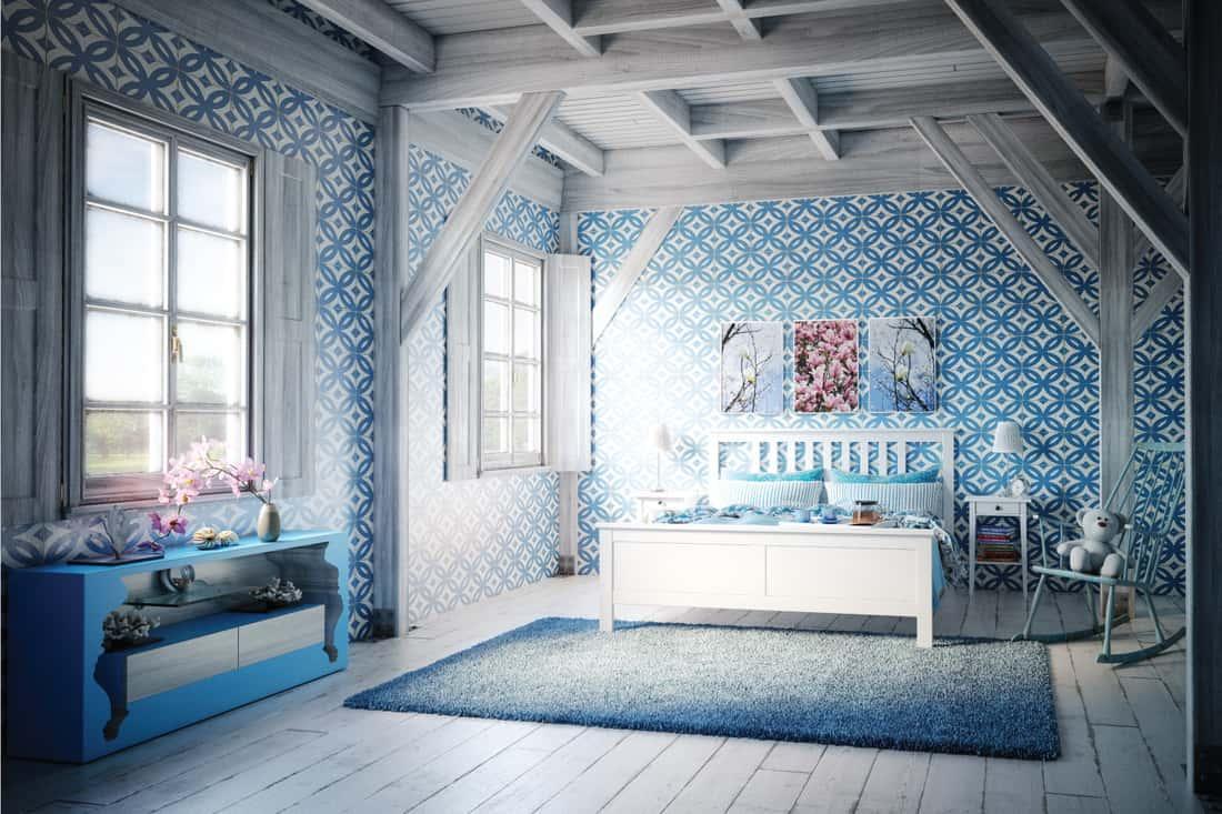 cozy blue themed Scandinavian bedroom interior design. barnyard blue wallpaper
