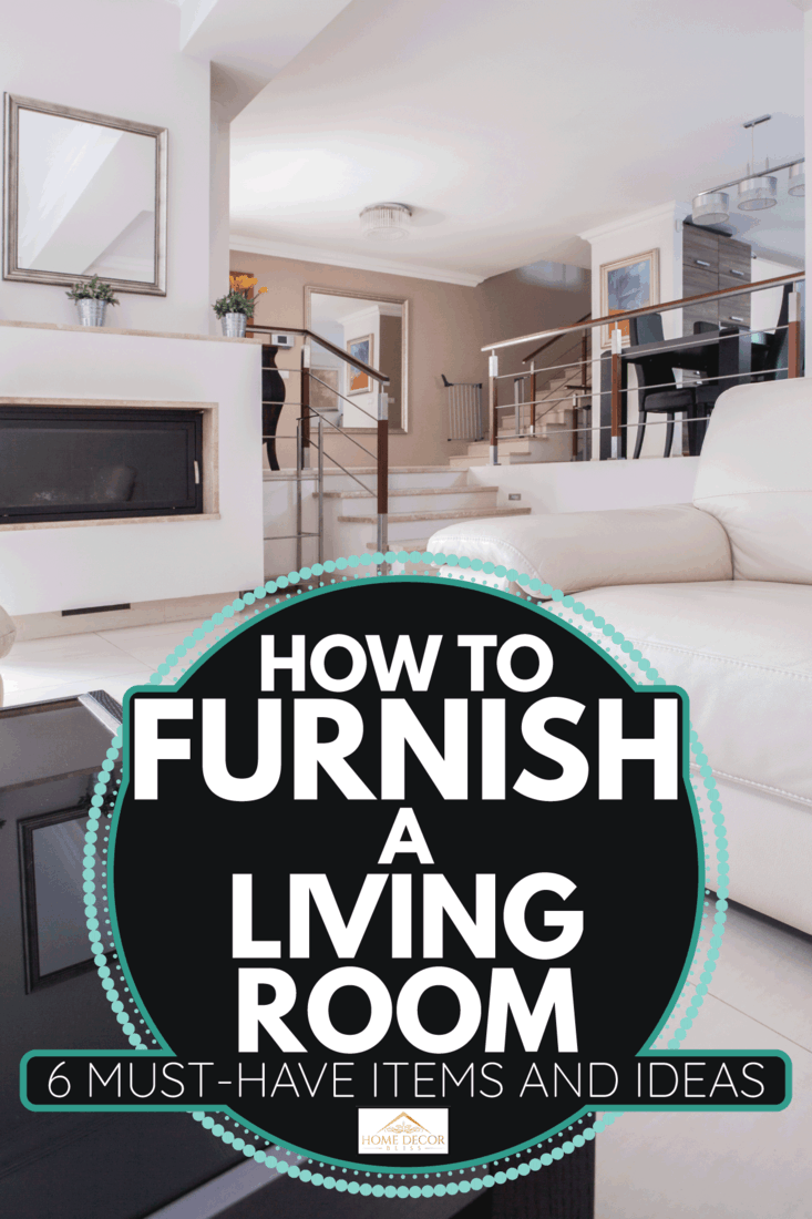 cozy fully furnished living room with small foyer, fireplace, center table, white sofa. How To Furnish A Living Room [6 Must-Have Items And Ideas]