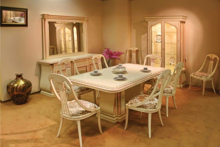dining room with mirror above a sideboard table. How High Should A Mirror Be Above A Sideboard