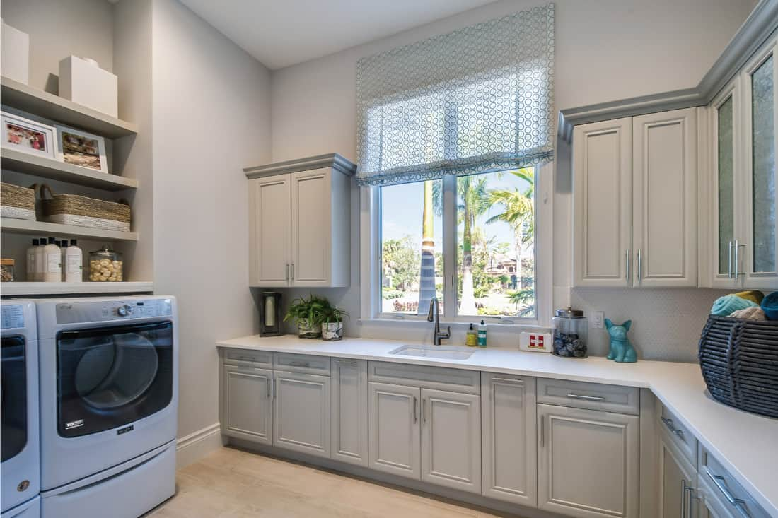 excellent utility space with hanging cabinets and shelves