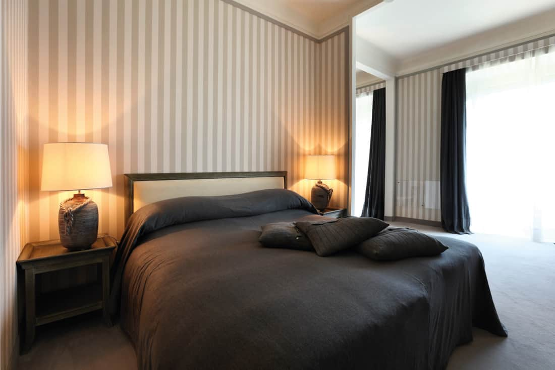 interior of a luxury bedroom with simple stripes wallpaper