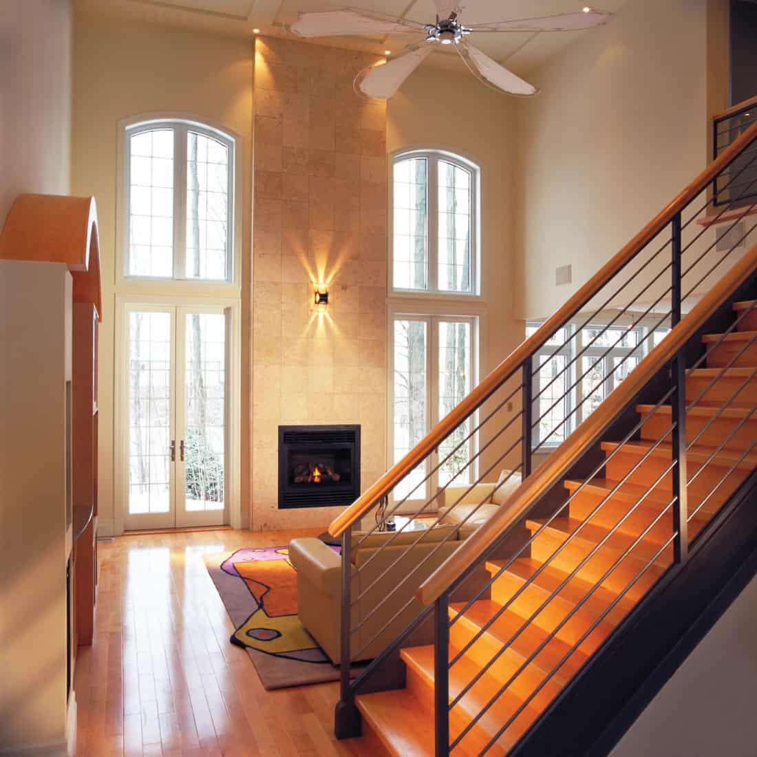 luxury living room with light sconces