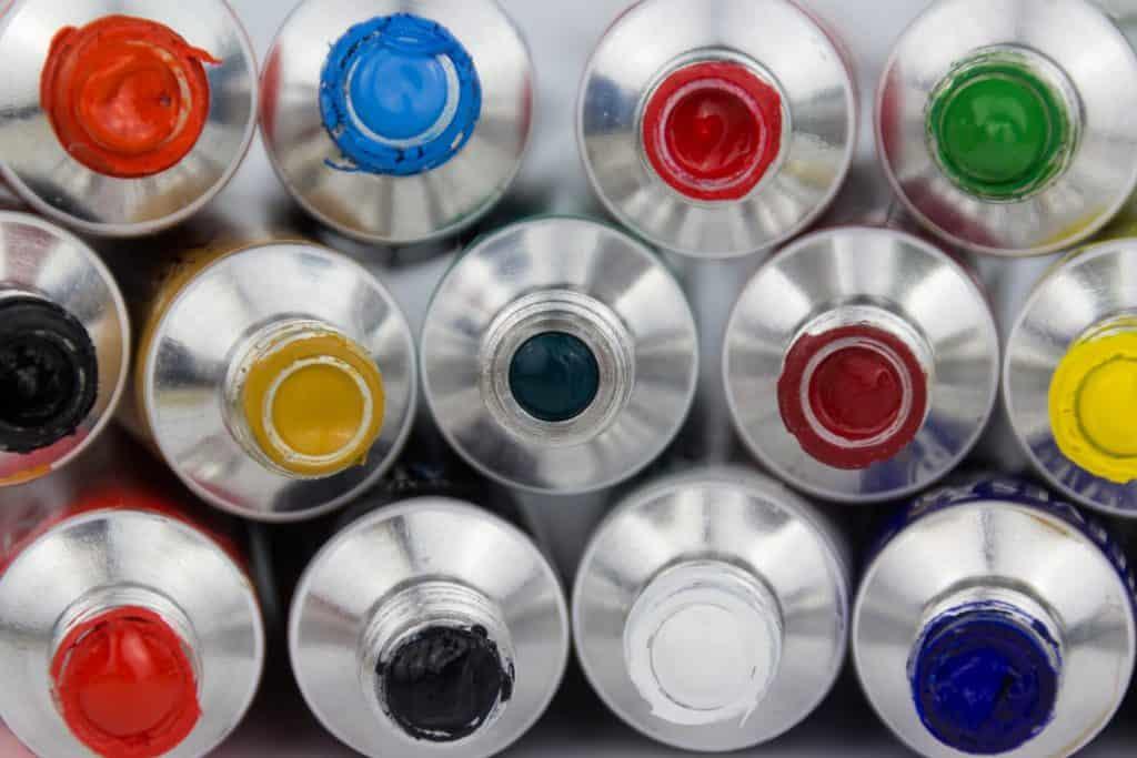 many color paint tubes macro on white background