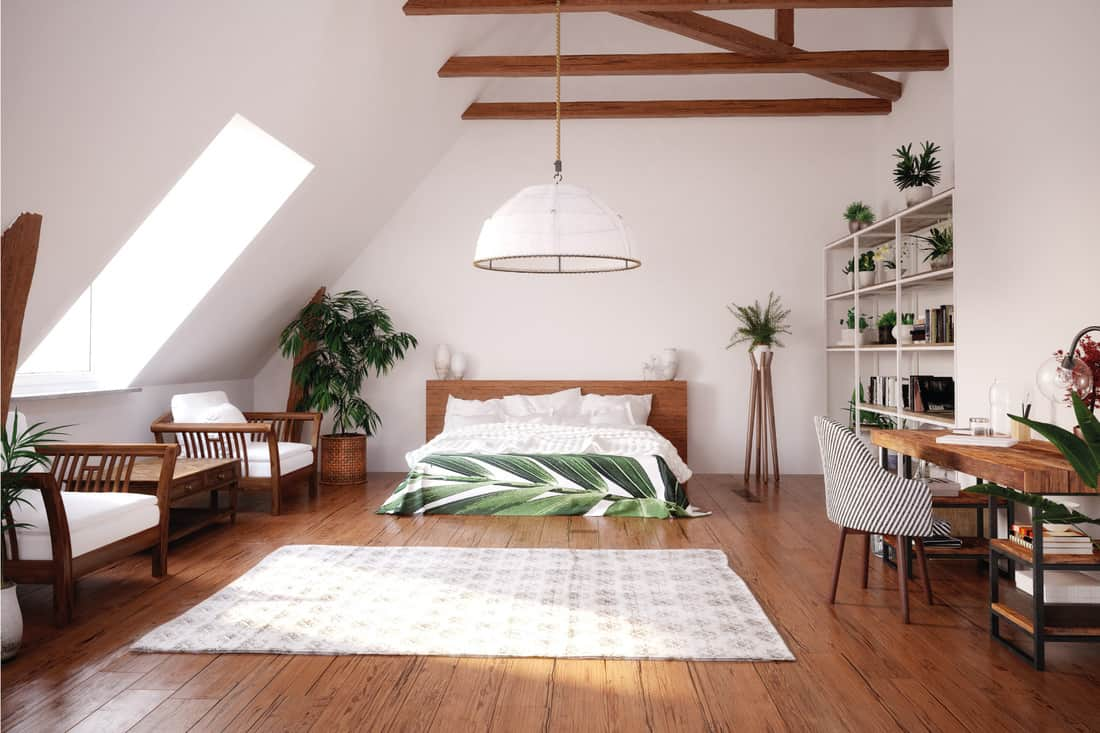 modern bright open space attic with bed, wood chairs, study area