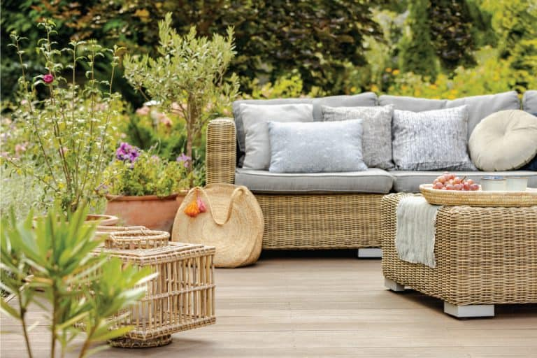 modern designed terrace with wicker furniture, seat cushion, throw pillows. How Long Does Outdoor Wicker Furniture Last
