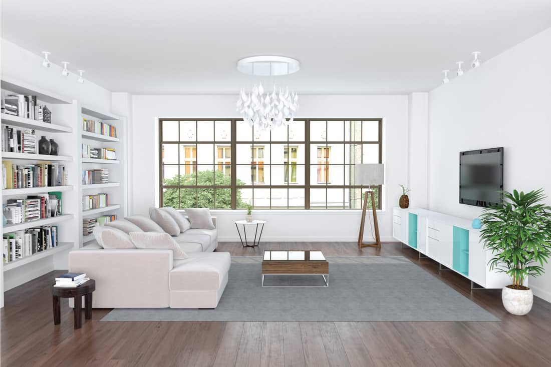 modern living room with open bookshelf, white sofa, center, side, and end tables
