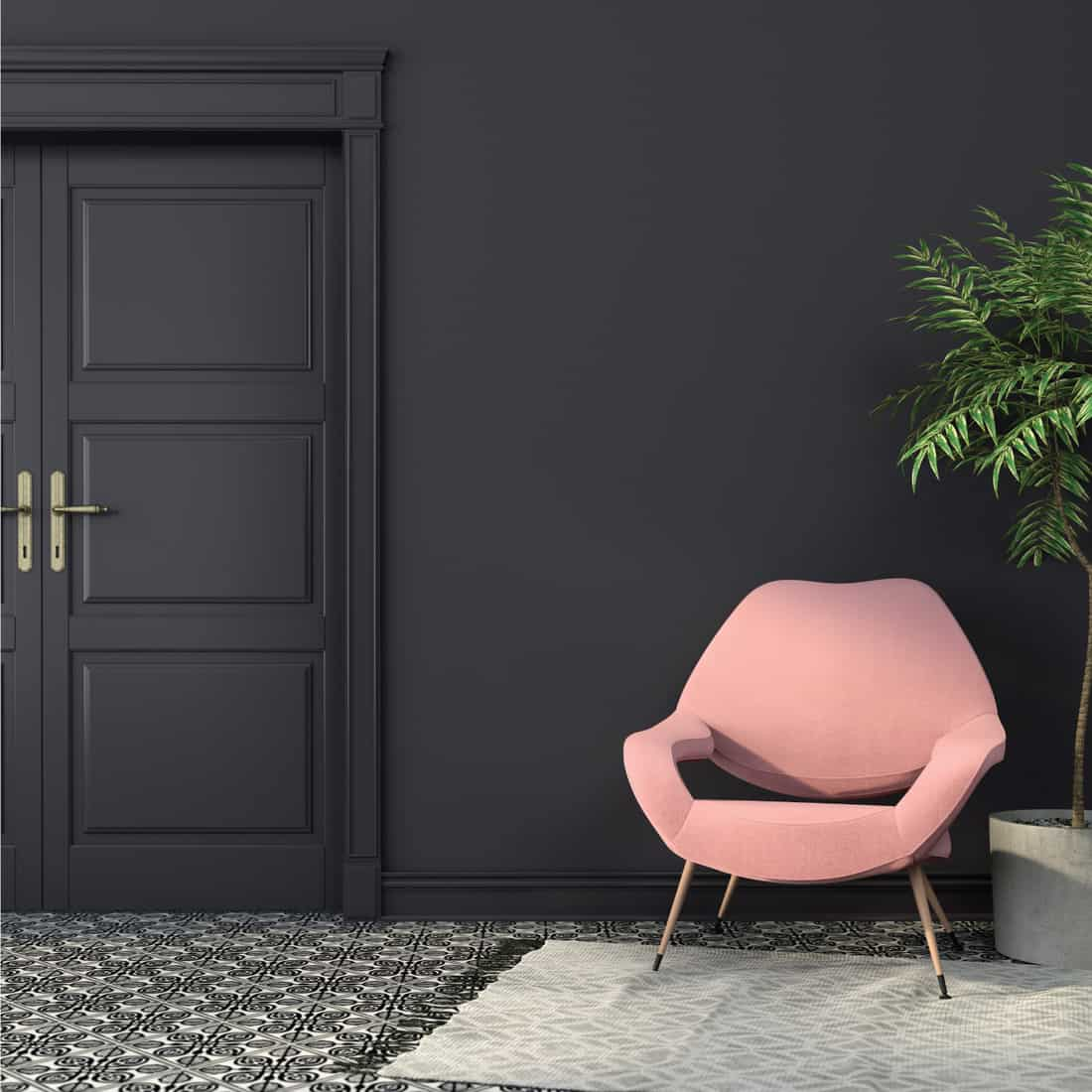 pink armchair inside a room with black or deep charcoal colored walls. black and white carpets