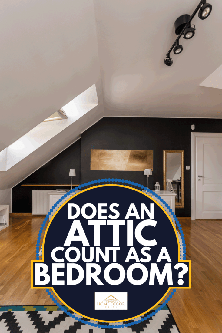 single bed in a attic bedroom with dark gray walls, white ceiling, and patterned carpet. Does An Attic Count As A Bedroom