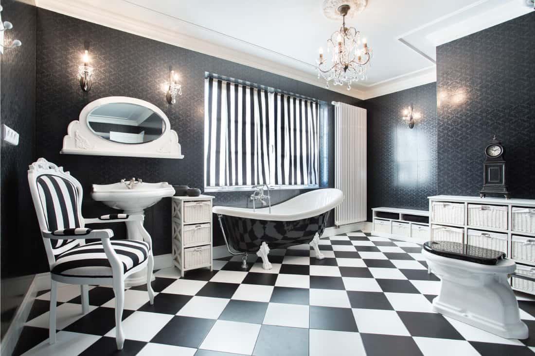 white and black modern bathroom. large square black and white flooring