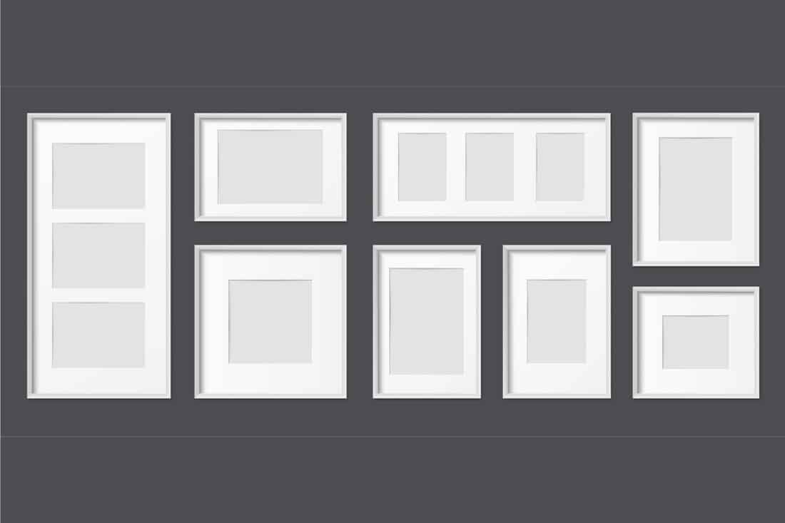 white frames set on a gray wall