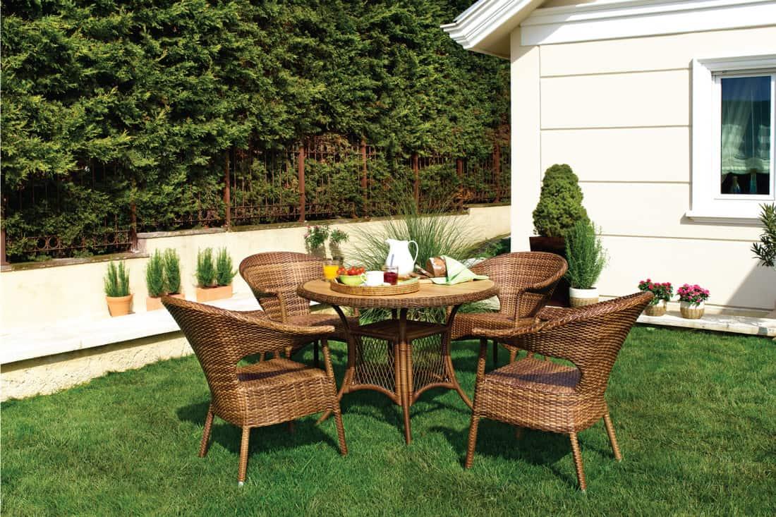 wicker furniture on the lawn in a backyard garden