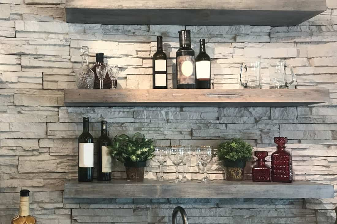 wooden kitchen open shelves with bottles