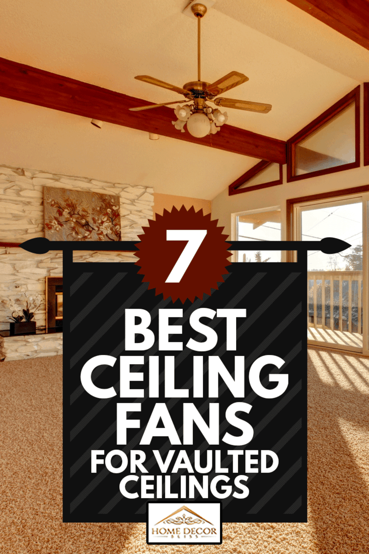 Empty living room with fireplace and a ceiling fan in vaulted ceiling, 7 Best Ceiling Fans For Vaulted Ceilings