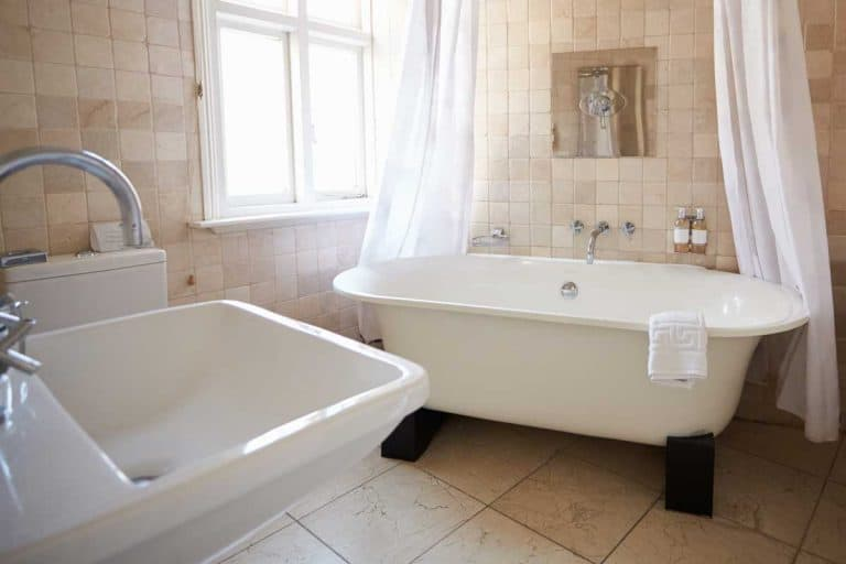 A bathroom with free standing bath and shower, How To Tell If A Bathtub And Shower Are Fiberglass Or Acrylic