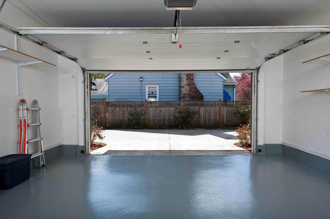A clean garage with floor painted in gray