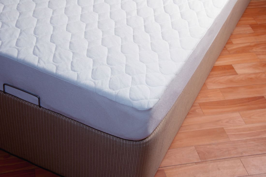 A comfortable mattress placed on a laminated flooring