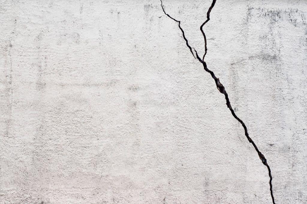A huge crack line on the Stucco wall