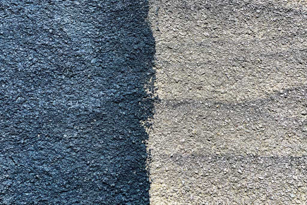 A photo of a driveway with one side sealed and other side unsealed
