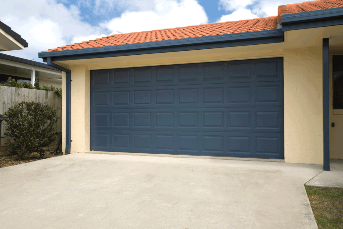 A spanish blue double garage door on a brand new home
