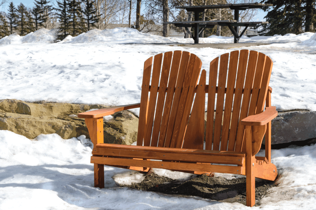 Adirondack double chair in the park, very early spring with still lots of snow on the ground