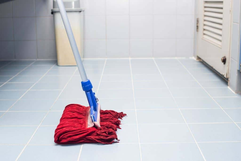 An up close photo of a woman cleaning the laundry room