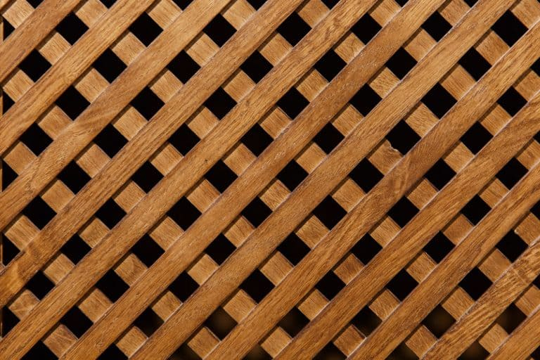 An up close photo of a wooden lattice for a porch, Is Wood Or Vinyl Lattice Better?