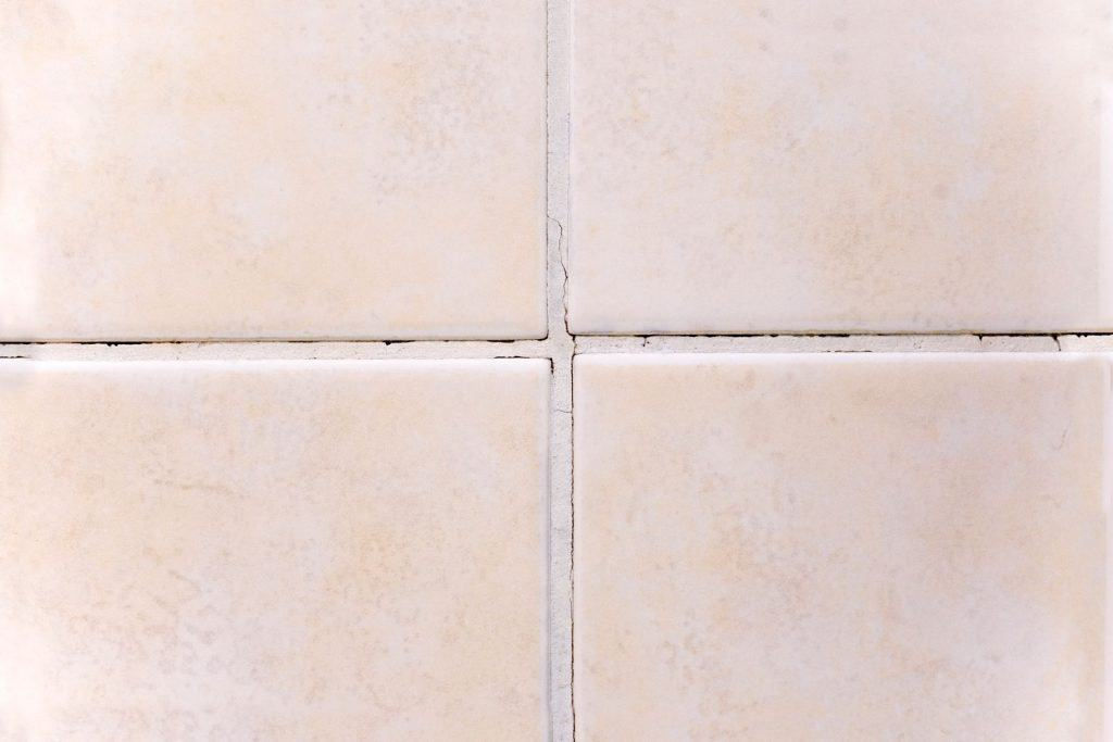 An up close photo of tiles and grout