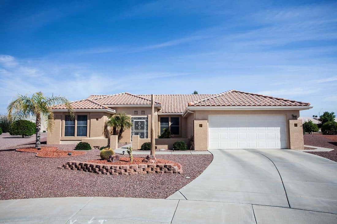 Arizona-style house with wide driveway to car garage