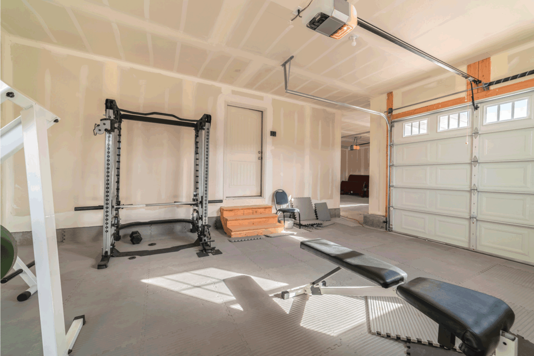 Assorted gym and fitness equipment in a garage. Assorted gym and fitness equipment in a garage converted to a workout room