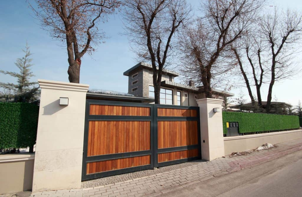 Automatic wooden sliding driveway gate