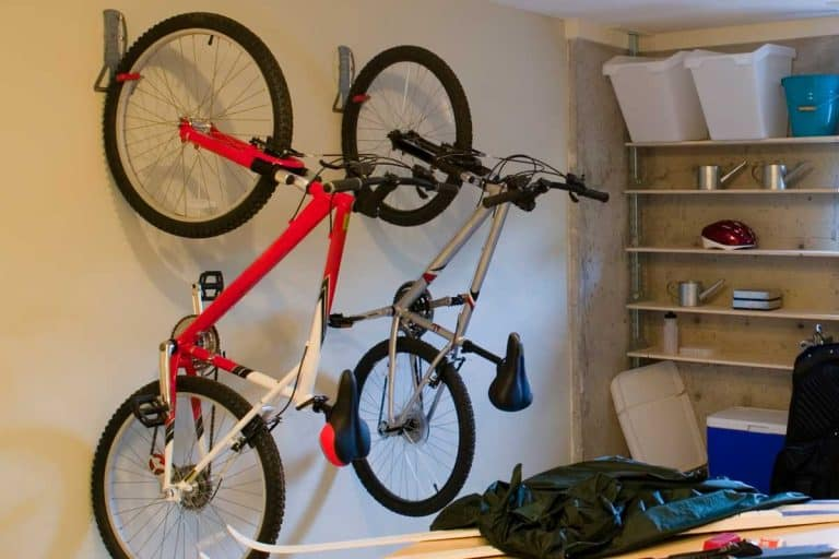 Basement house clutter garage storage with bike hanging on wall, 5 Of The Best Bike Hooks For Your Garage Wall